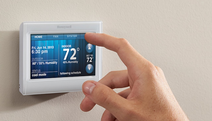 use programmable thermostat reduce heating bills winter